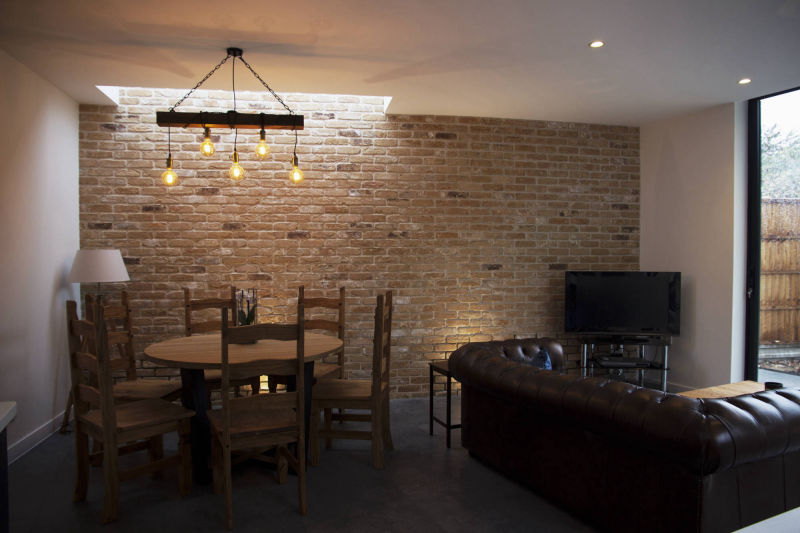 Exposed brick wall in a kitchen extension in Hertfordshire
