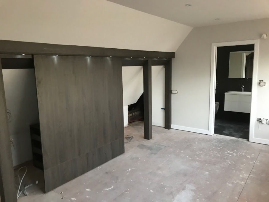 Construction of the interior of a dormer loft conversion - roof tiles and plaster