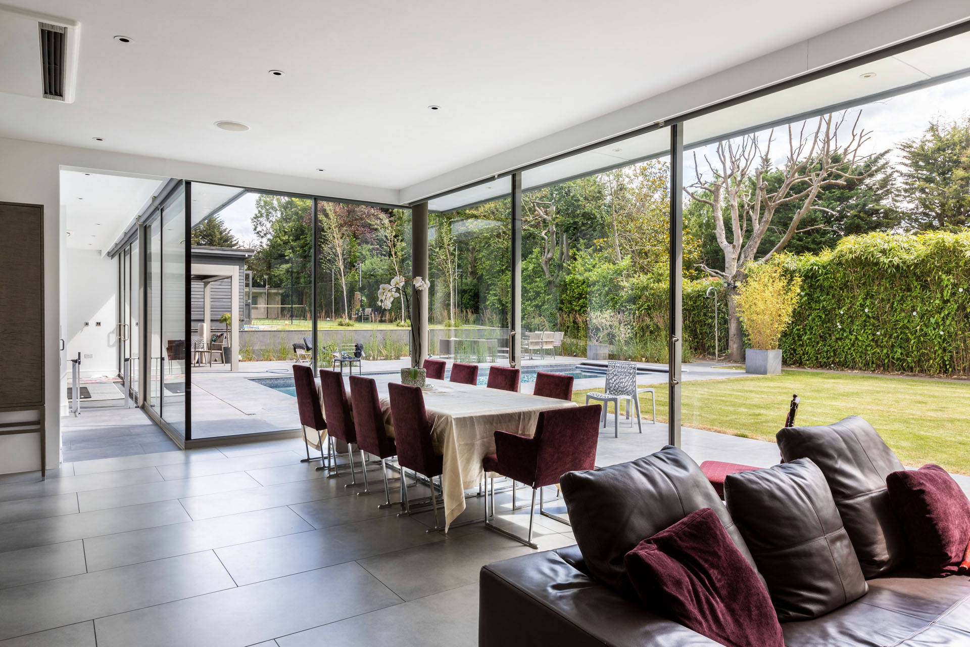 Sliding Glass Panels in an L Shaped House Extension in Mill Hill, London