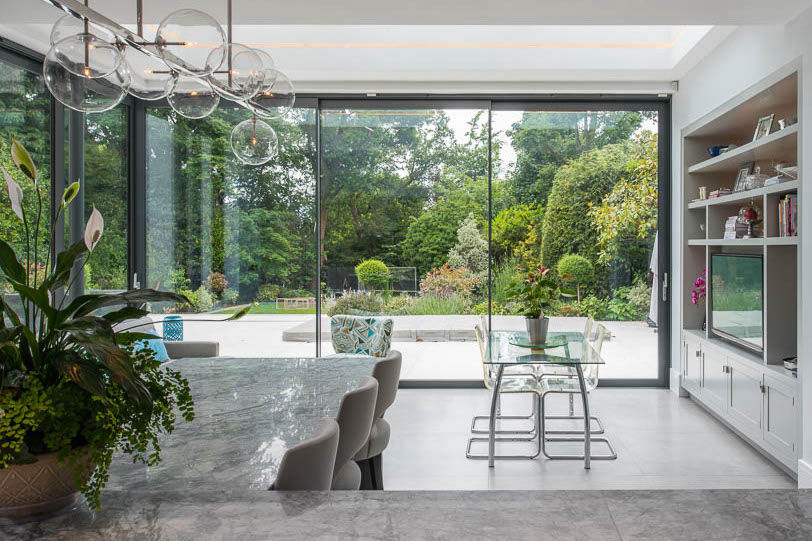 Sliding glass doors bringing light to a house extension