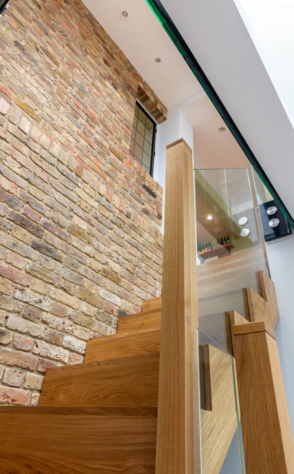Staircase leading into a basement of a Hampstead house extensions